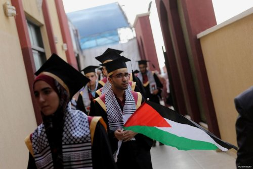 """Students prepare to attend their graduation ceremony after achieving high results known as """"Tawjihi""""in Gaza"""