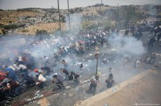 Israeli security forces attack Palestinians after Muslim worshippers perform Friday prayer, outside Al-Aqsa Mosque Compound 20 July 2017 [Mostafa Alkharouf/Anadolu Agency]