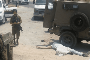The body of 26-year-old Muhammad Hussein lies on the ground after Israeli forces shot him dead on 20 July 2017 [Maa'n News]