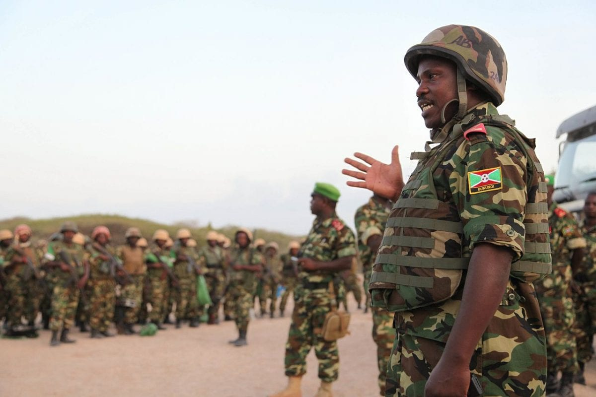 Soldiers belonging to the Burundian contingent of the African Union Mission in Somalia prepare to march on the Al Shabab held town of Ragaele in the Hiraan region of Somalia on September 30, 2014 [AMISOM]