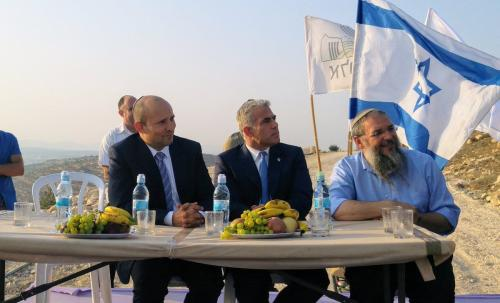 Yair Lapid, the head of the Yesh Atid party, and Israeli Education Minister Naftali Bennett, head of the ultra-right-wing Jewish Home Party, joined settlers on 23 July 2017 at the inauguration of a monument that was rebuilt in the illegal settlement outpost of Netiv HaAvot after the Israeli Supreme Court ordered the outpost's demolition and the evacuation of all settlers.[Yigal Dilmoni/Twitter]