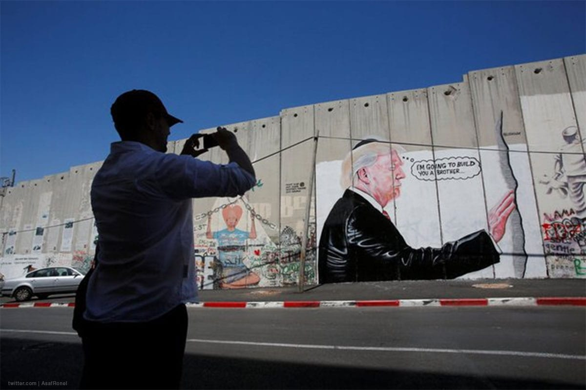 Graffiti depicting US Donald Trump when he visited Jerusalem's Western Wall, which Jews claim as their holiest site. [AsafRonel/Twitter]