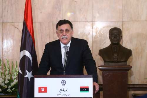 Chairman of the Presidential Council of Libya and Prime Minister of the Government of National Accord of Libya, Fayez al-Sarraj (C) holds a press conference on 7 August, 2017 [Yassine Gaidi/Anadolu Agency]