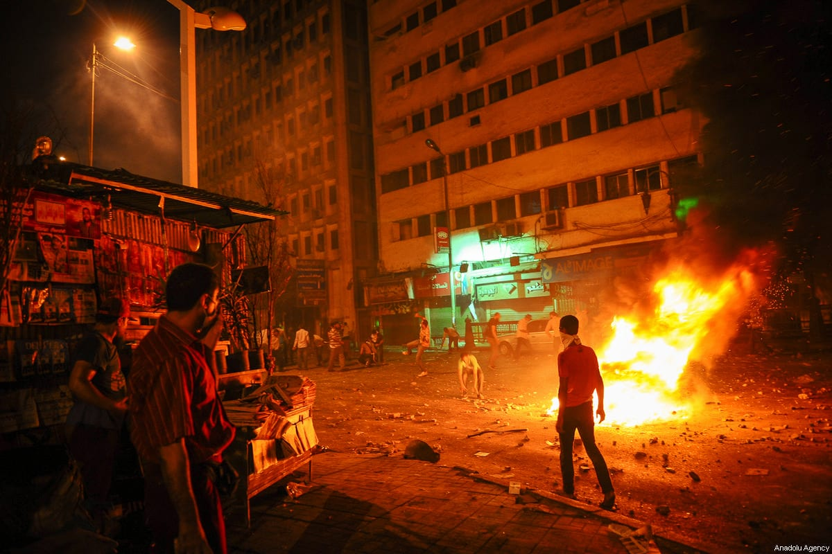 A file photo dated July 15, 2013 shows pro-Morsi protesters after gunshots by Egyptian security forces in Cairo, Egypt [Mohammed Elshamy/Anadolu Agency]