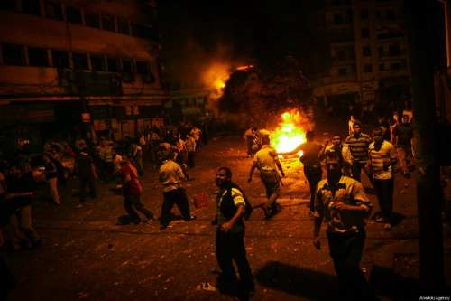 A file photo dated July 15, 2013 shows pro-Morsi protesters gesturing as a fire breaks after gunshots by Egyptian security forces in Ramsis Square in Cairo, Egypt [Mohammed Elshamy / Anadolu Agency]