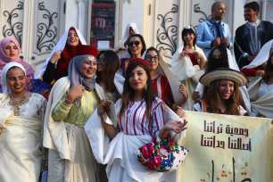 Tunisian women pose for a photo as they gather to celebrate Women's Day in Tunis, Tunisia on 13 August 2017 [Yassine Gaidi/Anadolu Agency]