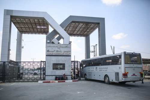 A bus, with passengers, crosses the Rafah Border to Egypt after going through passport controls in Rafah, Gaza on August 16, 2017. Egypt decided to open Rafah Border Gate for only 2 days in both directions. Mustafa Hassona - Anadolu Agency )