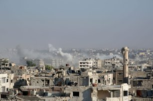 Smoke rises after Assad regime forces' carried out an air strike in the Ein Terma town of Eastern Ghouta, which is a de-conflict zone under control of opposition forces, in Damascus, Syria on August 17, 2017. ( Ammar Süleyman - Anadolu Agency )