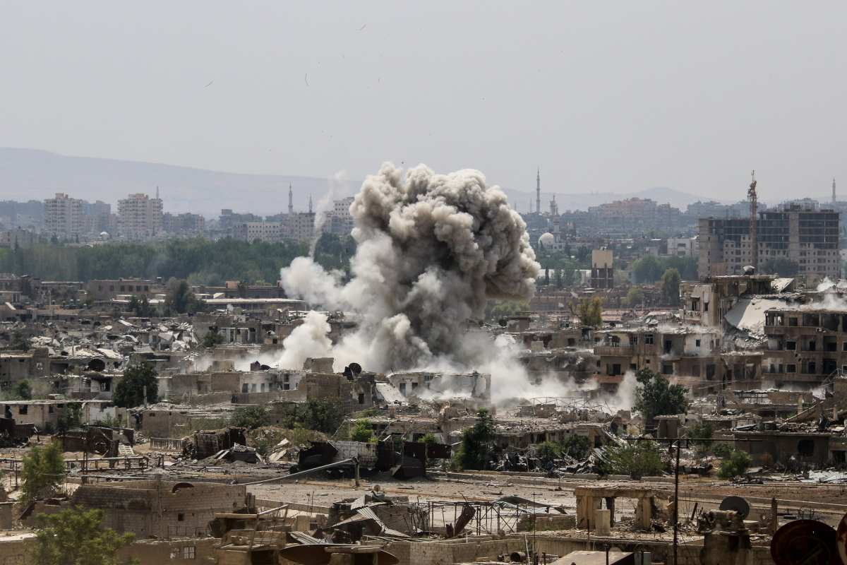 A huge explosion sends dark clouds into the air after Assad Regime forces carried out air and ground strikes over the agreed de-conflict zone, Cobar district in the Eastern Ghouta region of Damascus, Syria on August 20, 2017. ( Ammar Al-Bushy - Anadolu Agency )