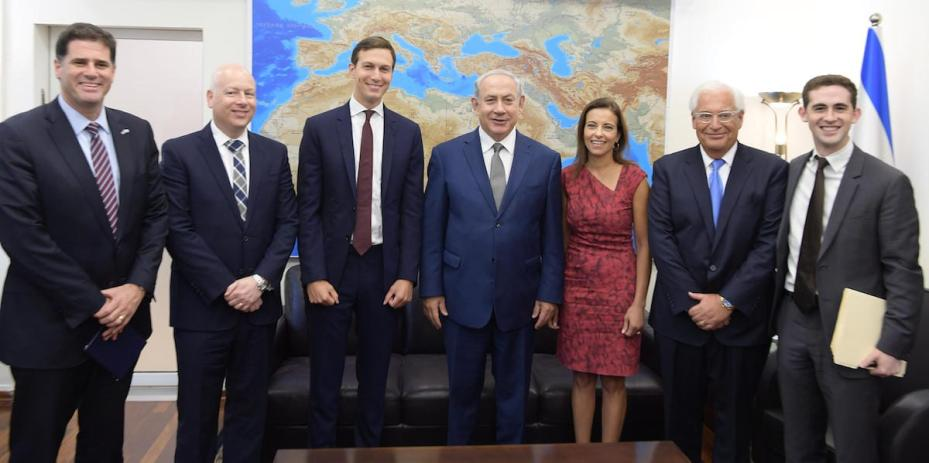 Jared Kushner (3rd L), US President Donald Trump's son-in-law and adviser, along with his delegation, pose with Israeli Prime Minister Benjamin Netanyahu (4th R) prior to their meeting at the prime minister's office in occupied East Jerusalem on 24 August 2017. [Israeli Prime Ministry /Handout]