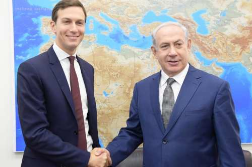 Jared Kushner (L), U.S President Donald Trump's son-in-law and adviser shakes hand with Israeli Prime Minister Benjamin Netanyahu (R) prior to their meeting at the prime minister's office in occupied East Jerusalem, Israel on 24 August 2017. [Israeli Prime Ministry /Handout ]
