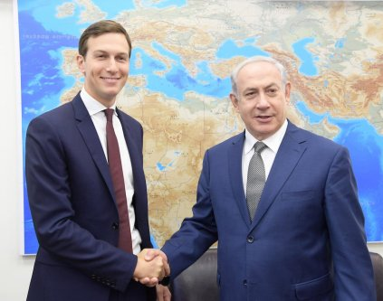 Jared Kushner (L), U.S President Donald Trump's son-in-law and adviser shakes hand with Israeli Prime Minister Benjamin Netanyahu (R) prior to their meeting at the prime minister's office in East Jerusalem, Israel on August 24, 2017. ( Israeli Prime Ministry / Handout - Anadolu Agency )