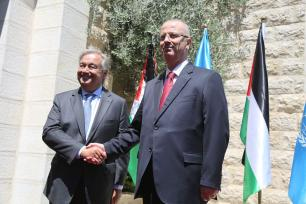 United Nations Secretary General Antonio Guterres (L) shakes hands with Prime Minister of Palestine Rami Hamdallah (R) as they pose for a photo during an official ceremony at Prime Ministry building due to Guterres' official visit in Ramallah, West Bank on August 29, 2017. ( Issam Rimawi - Anadolu Agency )
