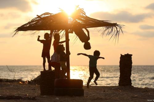 Palestinian children enjoy their time at the beach of the Mediterranean sea on the coast of Gaza city on 9 August, 2017 [Yasser Qudih/Apaimages]