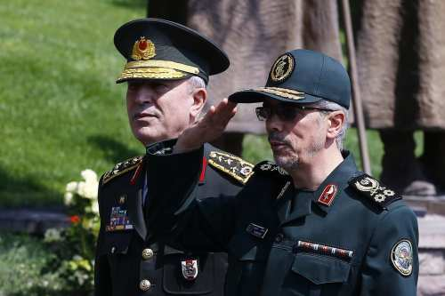 General Staff of the Armed Forces of Iran, Mohammad Bagheri (C) is welcomed by Chief of the General Staff of the Turkish Armed Forces Hulusi Akar (L) at Turkish General Staff headquarters, with a military ceremony during his official visit in Ankara, Turkey on 15 August, 2017 [ Mehmet Ali Özcan/ Anadolu Agency]