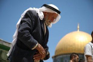 A Palestinian worshipper prays at the Al-Aqsa Mosque compound on 4 August 2017[Mostafa Alkharouf/Anadolu Agency]