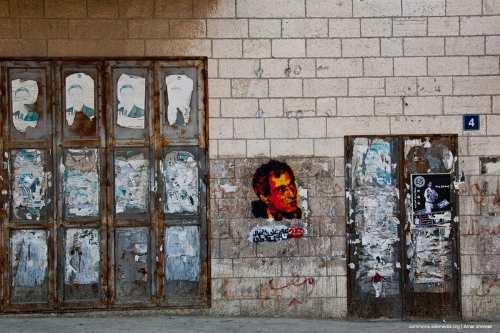 A Naji Al-Ali portrait on the 25th anniversary of his assassination. 4 color stencil graffiti, in Ramallah down town. Date 7 April 2012. [Image: Wikimedia]
