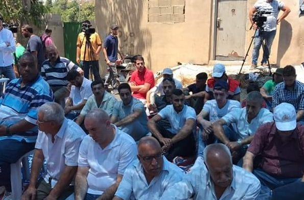 Palestinians gathered for Friday prayers on 11 August 2017 outside the Shamasna home in the Sheikh Jarrah neighbourhood of occupied East Jerusalem to show solidarity as the family is facing imminent evacuation to make room for Israeli settlers who claim they own the property. [Twitter/Al-Asqa TV]