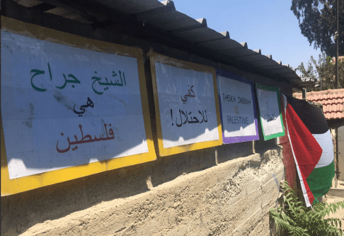 Posters are placed outside the Shamasna home in the Sheikh Jarrah neighbourhood of occupied East Jerusalem. The family faces imminent evacuation to make room for Israeli settlers who claim they own the property. The posters read 'No to occupation' and 'Sheikh Jarrah is Palestinian'. [Twitter/Quds TV]