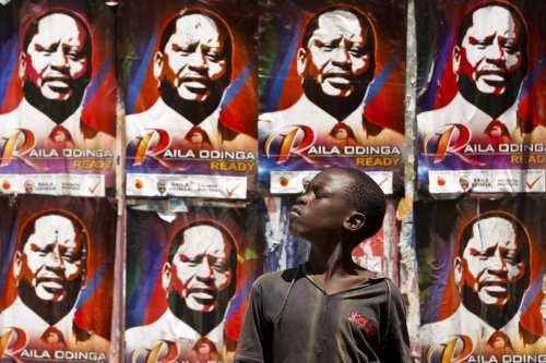 A young Kenyan boy looks on in front of the prime minister Raila Odinga's campaign posters on the wall near a polling station in the Kibera slum, Nairobi, Kenya, 04 March 2013 [EPA/Dai Kurokawa]