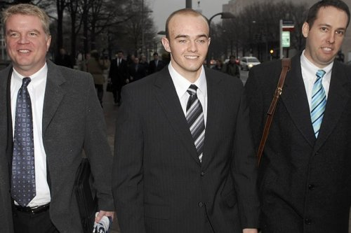 Former Blackwater Worldwide security guard Nick Slatten (C) and attorneys