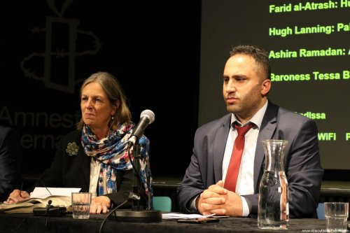 Palestinian activist Issa Amro (R) at an event organised by Amnesty International and the Palestine Solidarity Campaign in London, UK, on 25 September 2017. [Jehan Alfarra/Middle East Monitor]