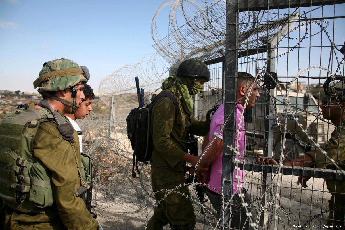 Israeli forces arrest a Palestinian youth on 23 October 2010 [Najeh Hashlamoun/Apaimages]