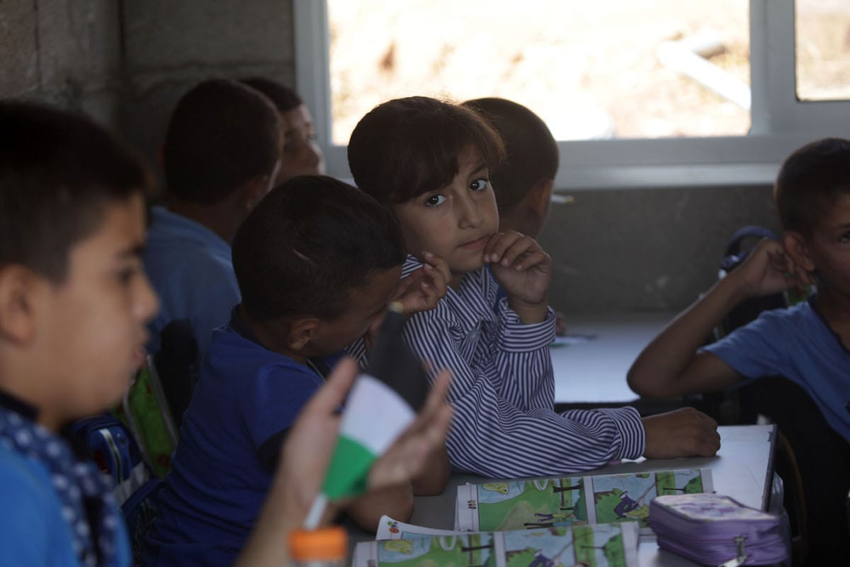 Students are seen during a lesson at Jub El-Thib village of Bethlehem, in West Bank on September 10, 2017. [Mamoun Wazwaz - Anadolu Agency]