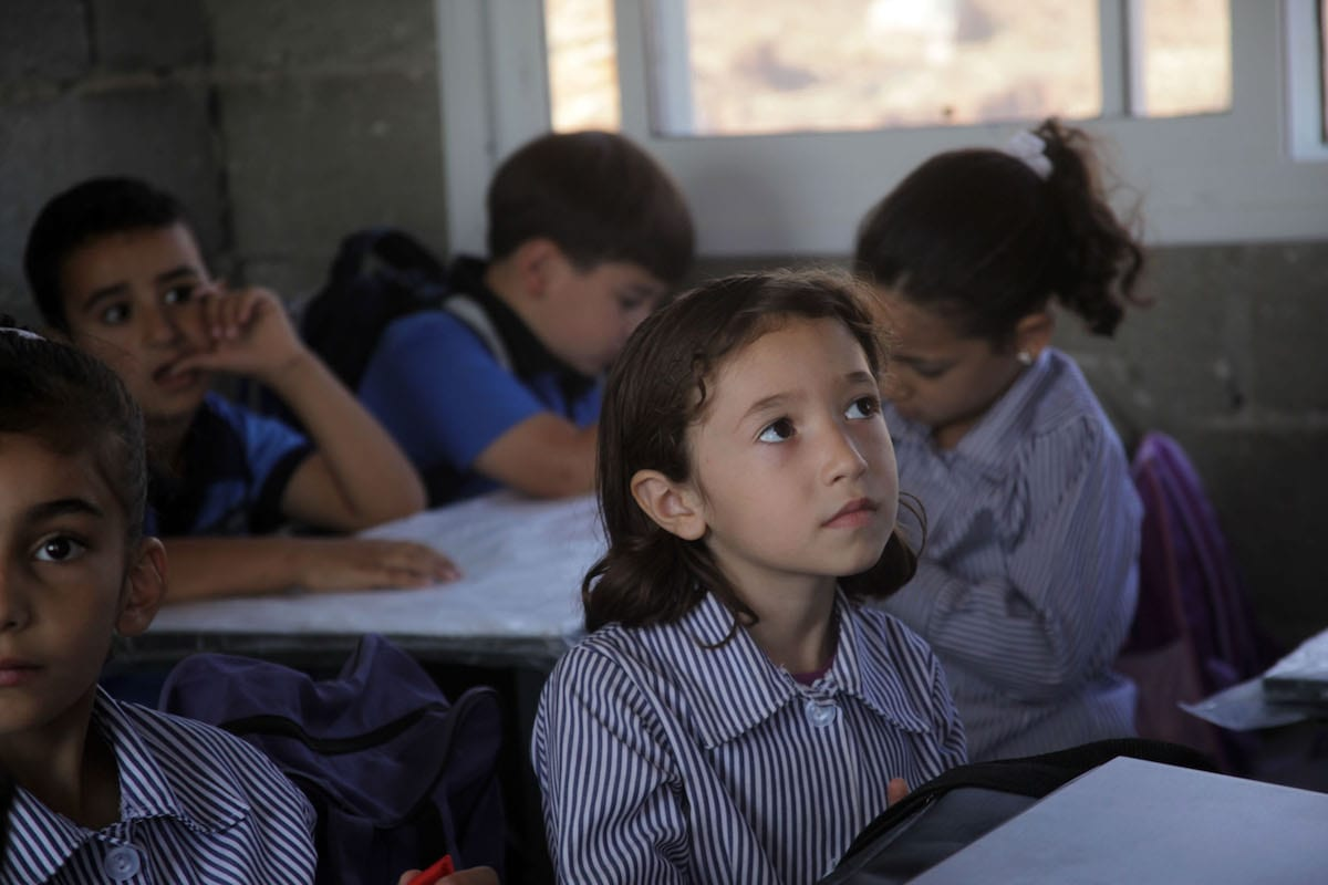Palestinian children can be seen at school in the West Bank on 11 September 2018 [Mamoun Wazwaz/Anadolu Agency]