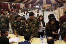 Peshmerga forces wait to cast their ballots in the Kurdish Regional Government (KRG) controversial referendum at a military polling station in Rashkin village of Erbil, Iraq on 25 September 2017. [Yunus Keleş/Anadolu Agency]