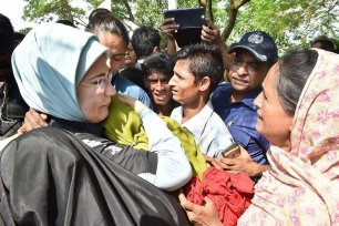 Turkey's First Lady, Emine Erdogan, handed out aid to Rohingya Muslim refugees during a visit to a camp near the Myanmar border