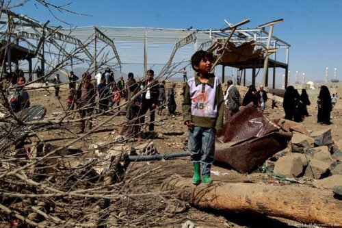 A Yemeni boy looks at the destruction of his home caused by an air strike carried out by the Saudi-led coalition [Mohamed A. Al-Moayed/Twitter]