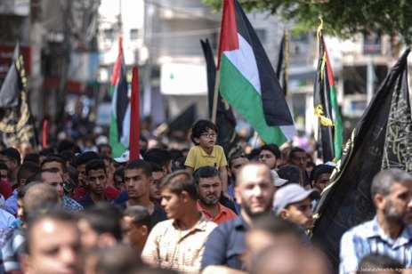 Palestinians march towards Zehra square during a protest against the embargo carried out by Israel for eleven years in Gaza City, Gaza on 8 September 2017 [Ali Jadallah/Anadolu Agency]
