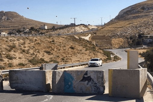Israeli occupation forces placed concrete blocks to stop Palestinians travelling along the Bethlehem-Nablus road in the occupied West Bank. [Maan]