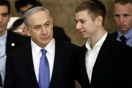 Israeli Prime Minister Benjamin Netanyahu (L) and his son Yair at Al-Aqsa's Buraq Wall (also known as the Western Wall) on 18 March 2015 in Jerusalem [AFP]