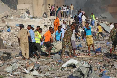People carry bomb attack victims from the scene in the capital Mogadishu, Somalia on October 14, 2017 [Sadak Mohamed / Anadolu Agency]