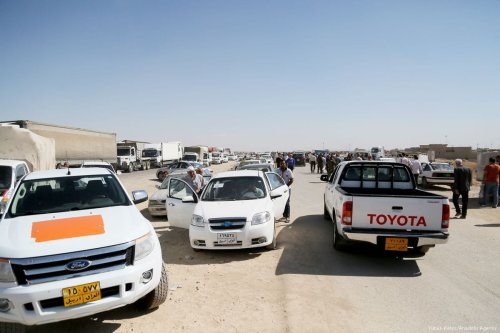 Cars and vehicles are seen near the reopened Erbil-Mosul road after Peshmerga forces, loyal to northern Iraqi Kurdish Regional Government (IKRG), have closed the main roads that linking the both cities in Erbil, Iraq on 12 October 2017 [Yunus Keleş/Anadolu Agency]