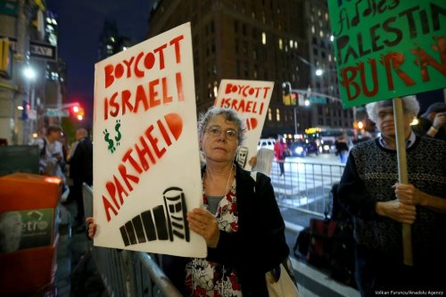 Human rights activists hold banners as they protest against Israel's occupation on Palestine in New York, US on 25 October 2017 [Volkan Furuncu/Anadolu Agency]