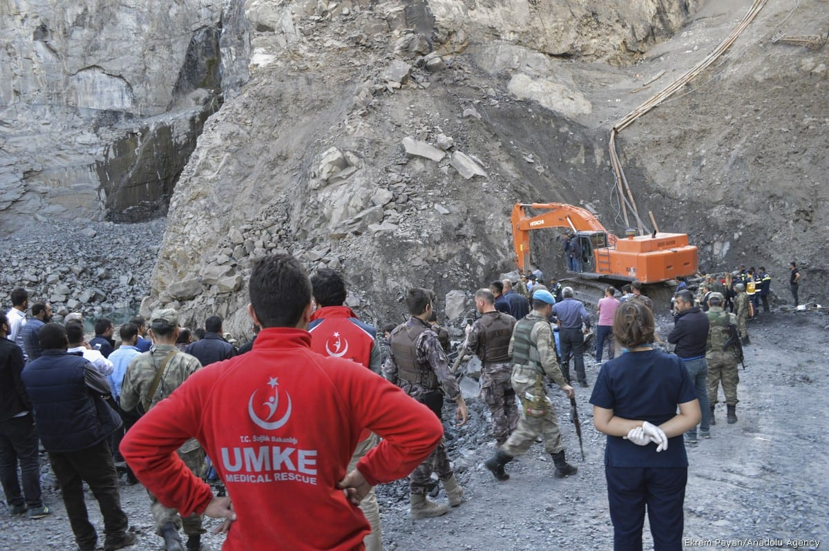 Search and rescue team along with security forces conduct a rescue operation on the debris after an illegal coal mine collapsed in Sirnak, Turkey on 17 October, 2017 [Ekrem Payan/Anadolu Agency]