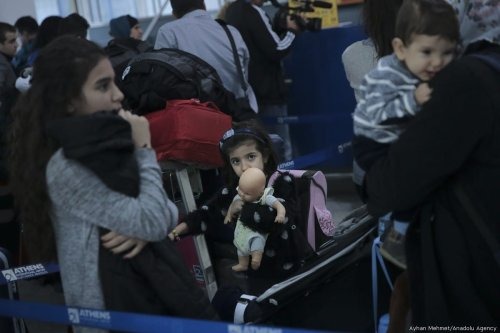 Children are seen at Athens International Airport as 234 refugees are transferred to Lyon of France within the EU Relocation Programme of International Organization for Migration (IOM) in Athens, Greece on 18 October, 2017 [Ayhan Mehmet/Anadolu Agency]