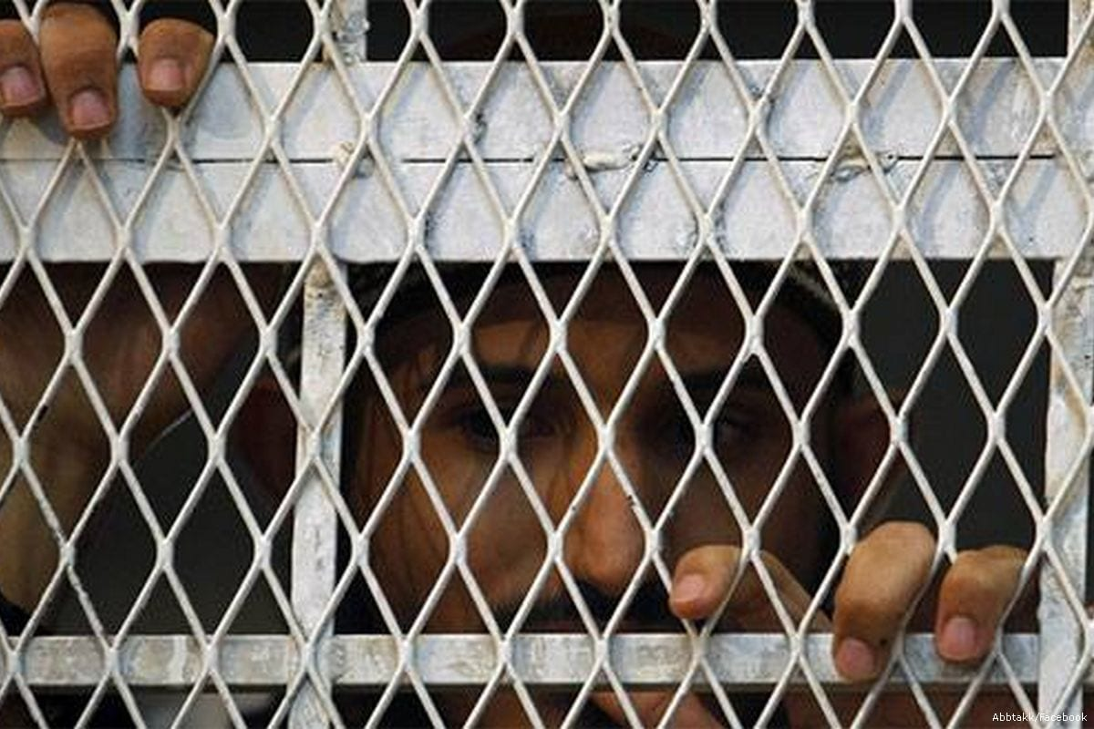 An inmate looks out of his prison cell in UAE [Abbtakk/Facebook]