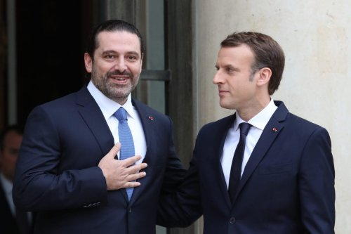French President Emmanuel Macron (R) welcomes Lebanese Prime Minister Saad Hariri (L) at the Elysee Palace in Paris, France on 18 November 2017 [Mustafa Yalçın/Anadolu Agency]