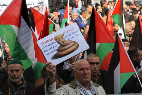 Palestinians protest against the plans by US President Donald Trump to move the US embassy in Israel to Jerusalem on 19 January 2017 [Nedal Eshtayah/Apaimages]