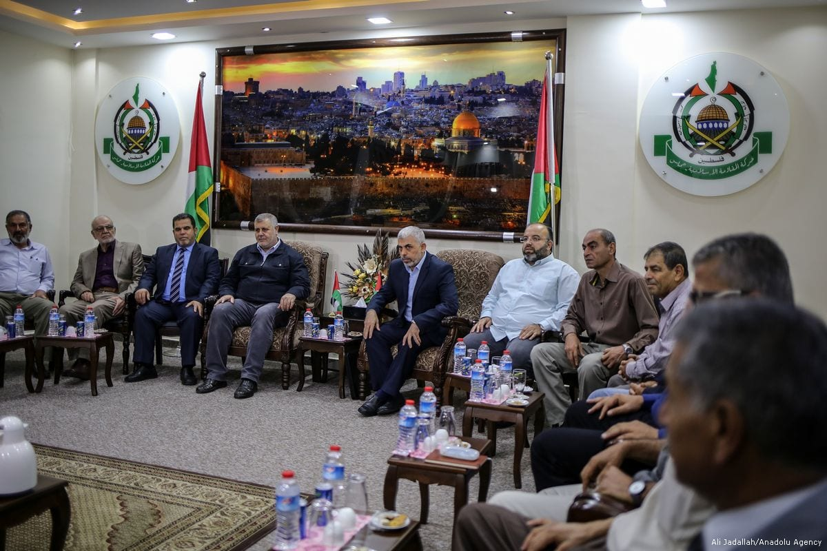 Leader of Hamas in Gaza, Yahya Sinwar (5th L) gathers with Palestinians groups to evaluate the reconciliation deal, signed between Hamas and Fatah, in Gaza City, Gaza on 28 September 2017 [Ali Jadallah/Anadolu Agency]