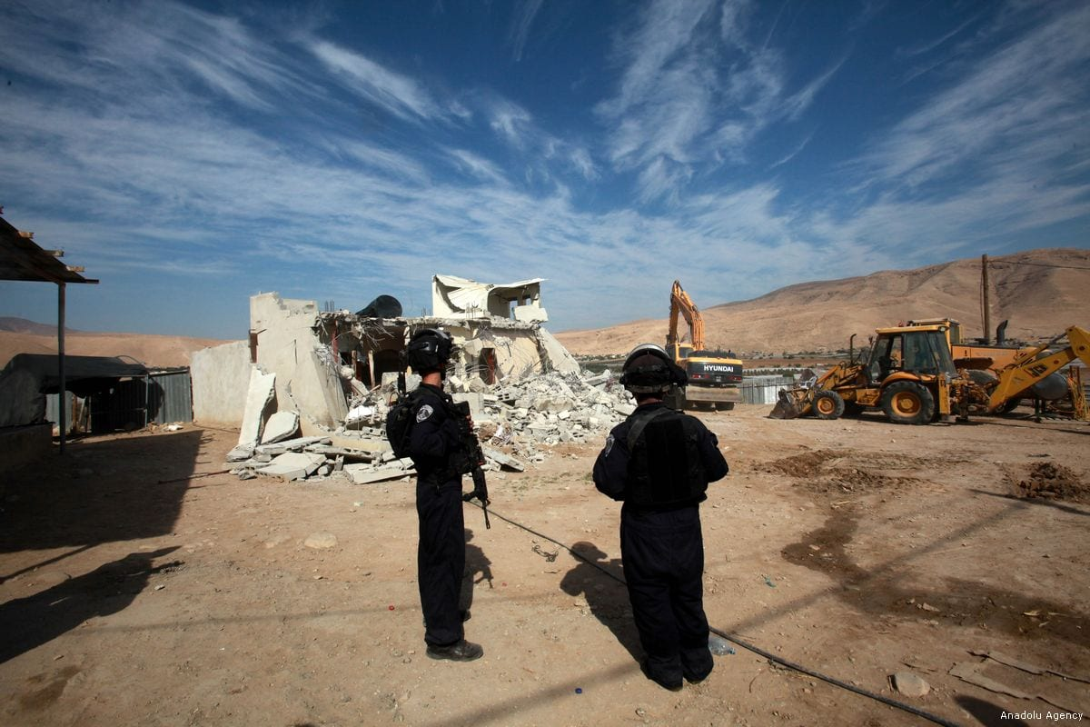 Israeli security forces guard the area during a Palestinian home demolition at a farm in north of Jordan Valley in Tubas, West Bank on November 07, 2017 [Nedal Eshtayah / Anadolu Agency]