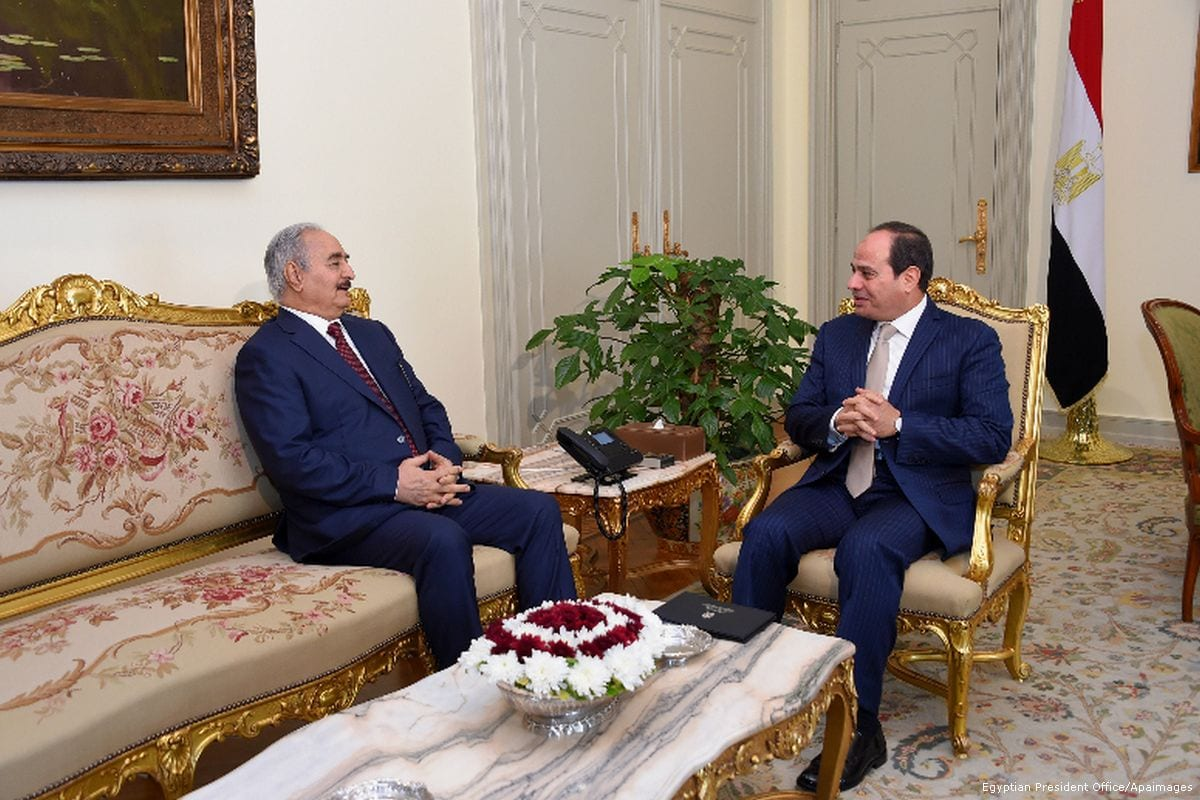 Egyptian President Abdel Fattah Al-Sisi meets with Commander of the Libyan national army Field Marshal Khalifa Haftar, in Cairo, Egypt, on 13 May 2017 [Egyptian President Office/Apaimages]
