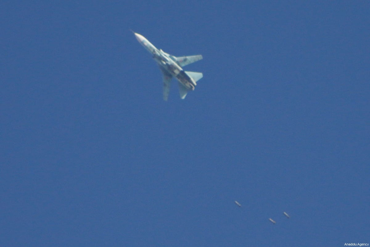 A fighter jet, belonging to either the Syrian or Russian air force drops bombs during an airstrike over residential areas of Arbin town of the Eastern Ghouta region of Damascus in Syria on December 2, 2017 [Samir Tatin / Anadolu Agency]