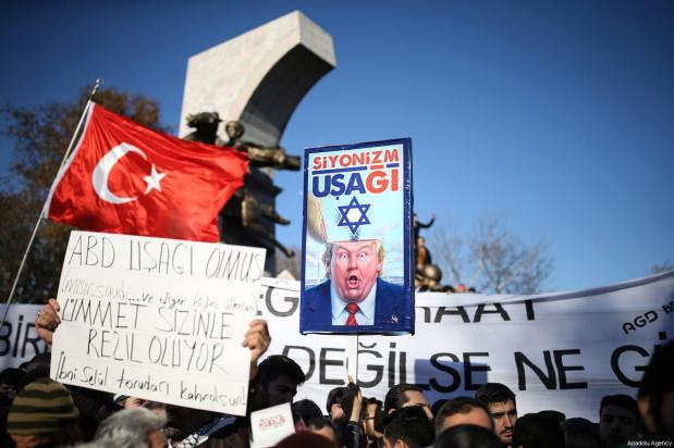 People stage a protest against US President Donald Trump's announcement to recognise Jerusalem as the capital of Israel and plans to relocate the US Embassy from Tel Aviv to Jerusalem, on December 8, 2017 in Istanbul, Turkey [Onur Çoban / Anadolu Agency]
