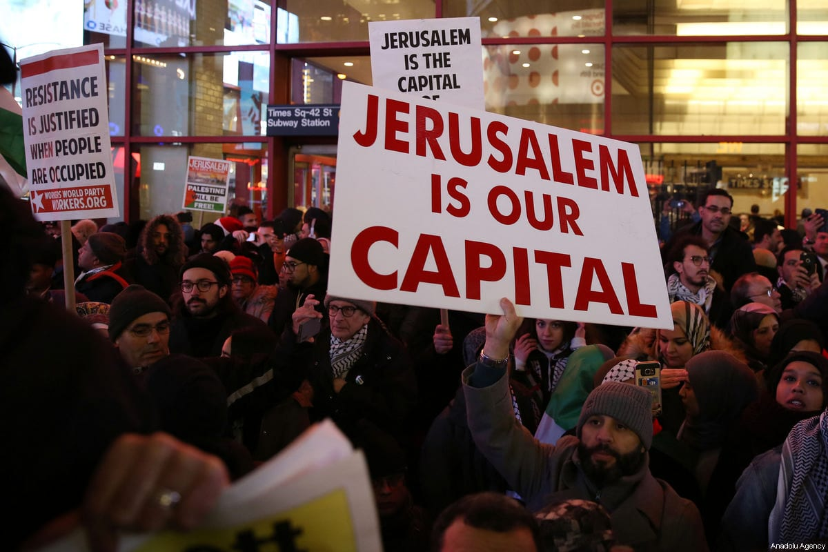 People attend a demonstration against US President Donald Trump's recognition of Jerusalem as Israel's capital, at the Times Square in New York City, United States on December 09, 2017 [Mohammed Elshamy / Anadolu Agency]