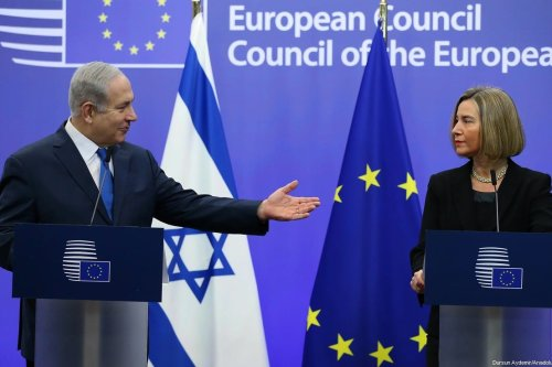 Israeli Prime Minister Benjamin Netanyahu (L) holds a joint press conference with High Representative of the European Union (EU) for Foreign Affairs and Security Policy and Vice-President of the European Council Federica Mogherini (R) at the European Council headquarters within the EU Foreign Affairs Council in Brussels, Belgium on December 11, 2017. [Dursun Aydemir/Anadolu Agency]